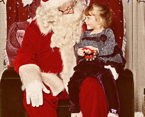 Little girl visits Santa Claus